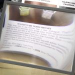 A hands free sheet magnifier that is easily stored